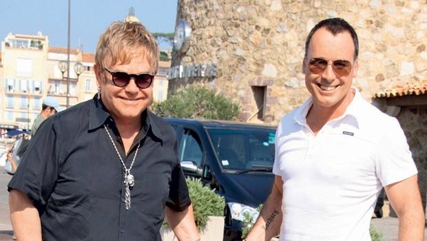Elton John z možem Davidom Furnishem in sinom Zacharyem (foto: Profimedia.si)