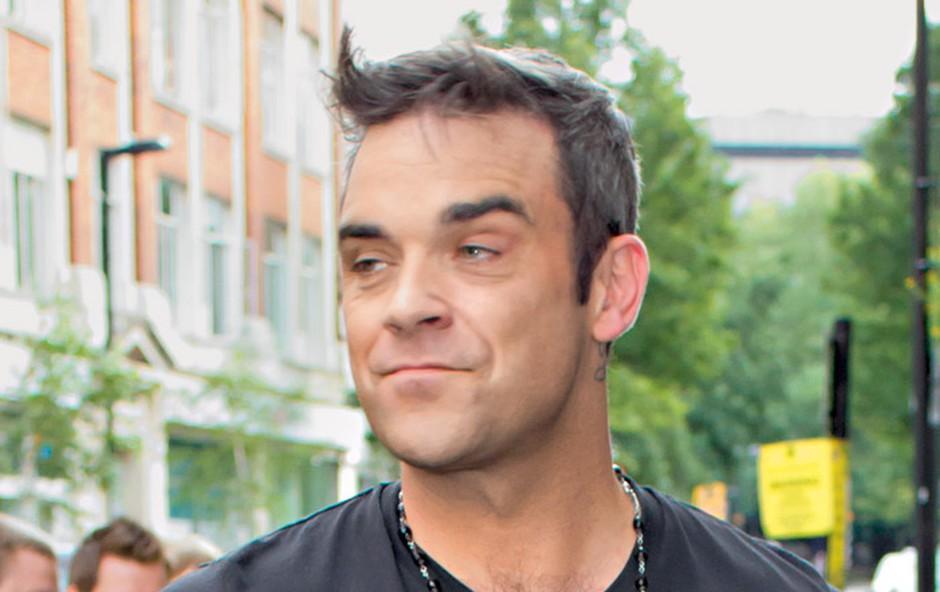 Robbie Williams: Sam sebi se zdi kot portir (foto: Shutterstock)