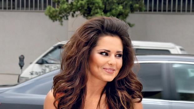 Ker je Cheryl lani v šovu X Factor zaradi nerazumljivega naglasa dobila odpoved, se je odločila za tožbo.    (foto: Profimedia.si)