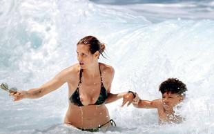 Fotografija Heidi Klum, ki je v trenutku obkrožila svet