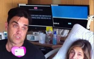 Robbie Williams snemal rojstvo sina in videe delil z oboževalci