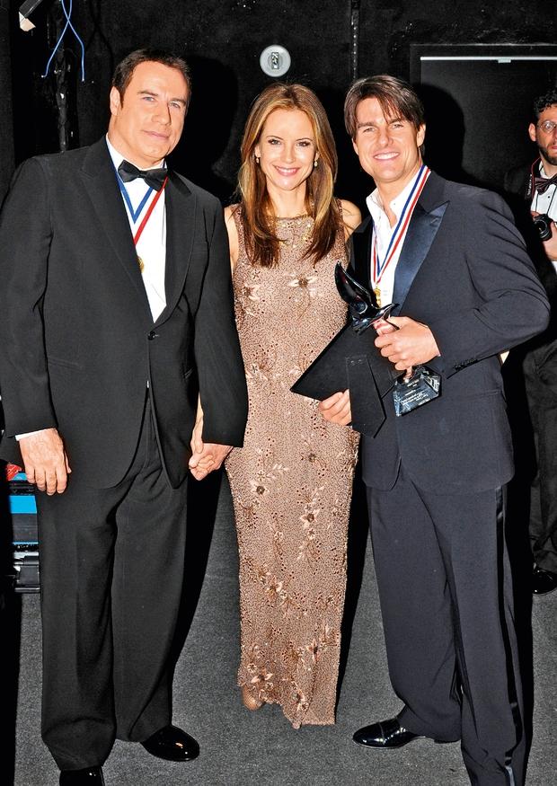 Člani zloglasne sekte izsiljujejo Toma Cruisea ter Johna Travolto (foto: Lea)