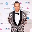 Robbie Williams: V devetdesetih je toliko pil in se drogiral, da je skoraj umrl!