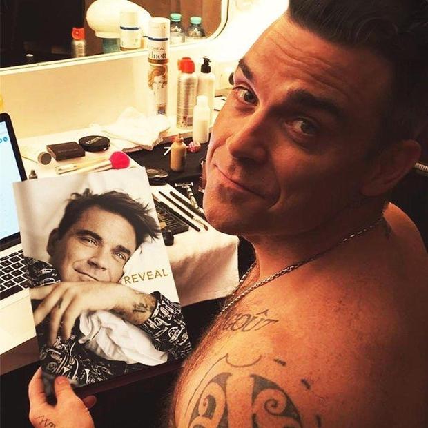Robbie Williams v brutalno iskreni biografiji Odkrito: »Prečkal sem obzorje, pa sem še vedno tu!« (foto: profimedia)