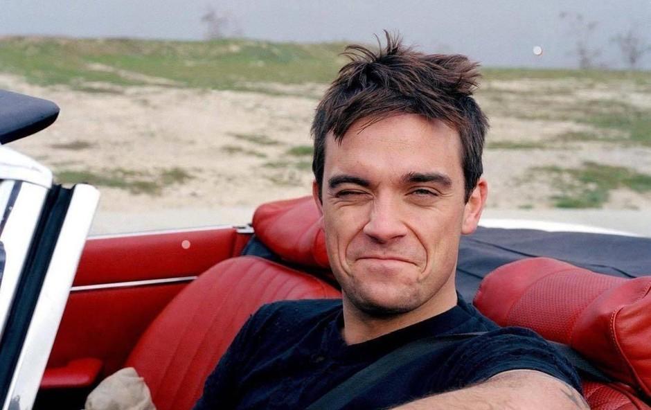 Robbie Williams s pomočjo nadomestne mame vnovič postal očka! (foto: profimedia)