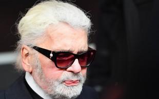 Karl Lagerfeld se je v Parizu po dolgem času nasmejal in šokiral z zobmi