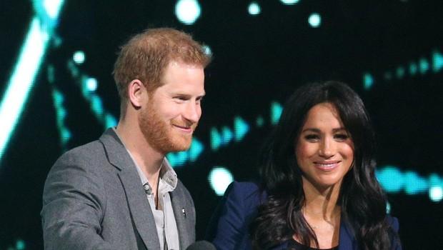 Takole je princ Harry na oder povabil vojvodinjo Meghan in se ji zahvalil za vse. (foto: Profimedia Profimedia, Press Association)