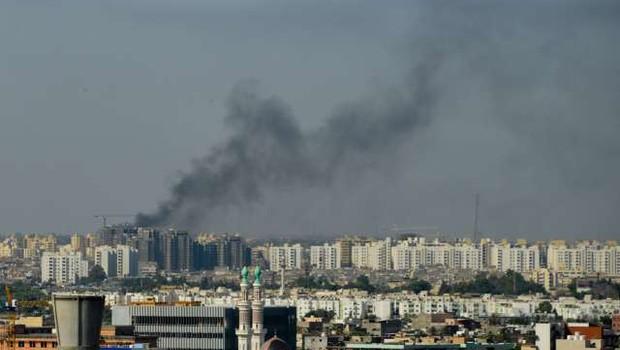 V napadu na migrantski center pri Tripoliju več deset mrtvih (foto: STA/Xinhua)