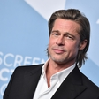 Brad Pitt bril norce iz princa Harryja in Meghan Markle, princ William in Kate Middleton pa sta se sladko smejala