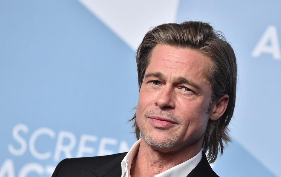 Brad Pitt bril norce iz princa Harryja in Meghan Markle, princ William in Kate Middleton pa sta se sladko smejala (foto: Profimedia)